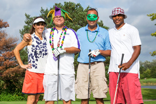 MACK Companies employees playing golf